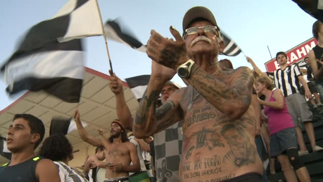stockvideo's en b-roll-footage met in brazil the host of the 2014 world cup football is an inherent part of the culture voiced the man with 83 tattoos devoted to a braz on february 05... - wereldkampioenschap sport