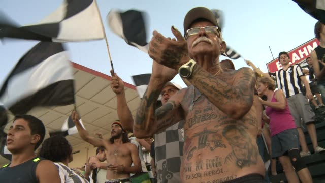 stockvideo's en b-roll-footage met in brazil the host of the 2014 world cup football is an inherent part of the culture clean the man with 83 tattoos devoted to a brazi on february 05... - wereldkampioenschap sport