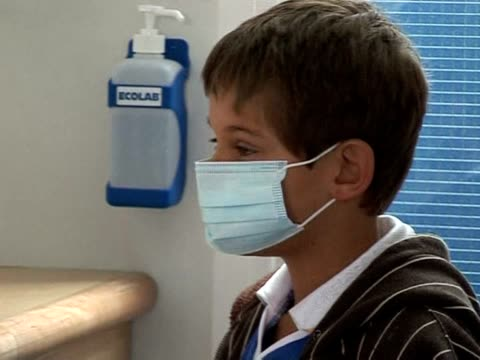 in britain about 100000 new cases of swine flu have been reported in the last week alone and at least 30 people have died in total london greater... - 2009 stock videos & royalty-free footage