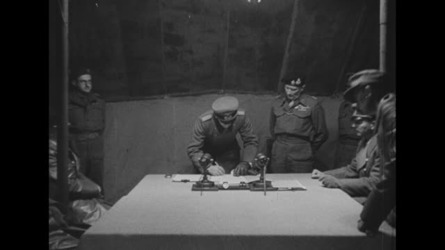 in british hq tent at luneburg heath german rear adm gerhard wagner signs instrument of surrender of all german forces in holland nw germany and... - arrendersi video stock e b–roll