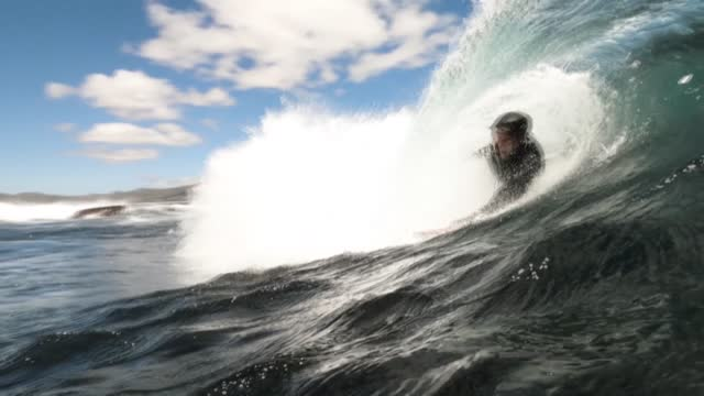 in cape town, a handful of purists practice bodysurfing, a type of surfing without boards or bragging, the closest you can possibly get to the waves - surf stock videos & royalty-free footage