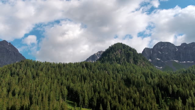 in car perspective looking out of a window at a dolomite landscape, val gardena, italy - val gardena video stock e b–roll