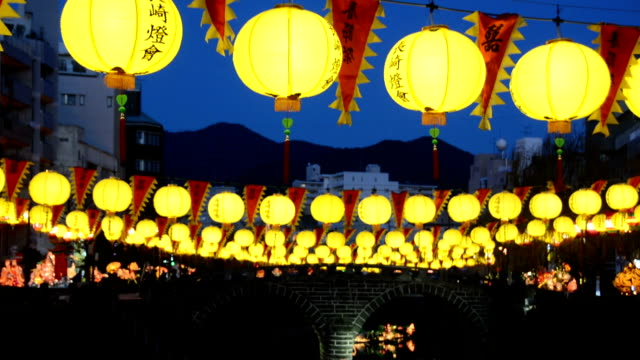 in celebration of the traditional chinese new year nagasaki's chinatown district lit up a display of about 15000 colorful lanterns and floats on... - chinesisches laternenfest stock-videos und b-roll-filmmaterial