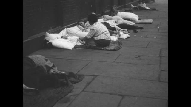 in chicago shot from ground level of people sleeping on fire escapes of tenement building / people sleeping on sidewalk / two children sleeping on... - dessert video stock e b–roll