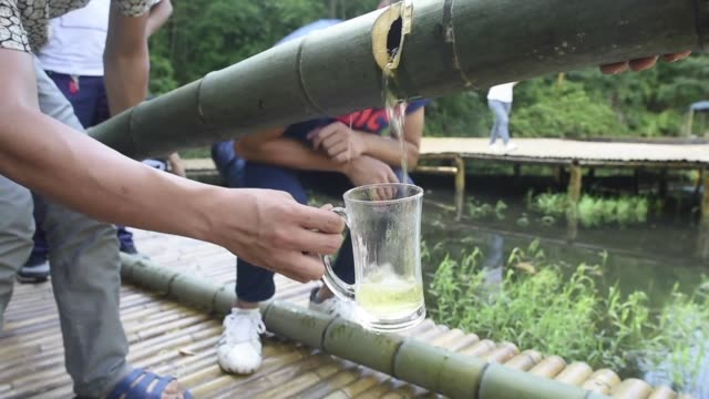 in china's southwestern sichuan province people use live bamboo trunks to age alcohol a method reputed to confer a unique aroma and even medicinal... - new age stock videos & royalty-free footage