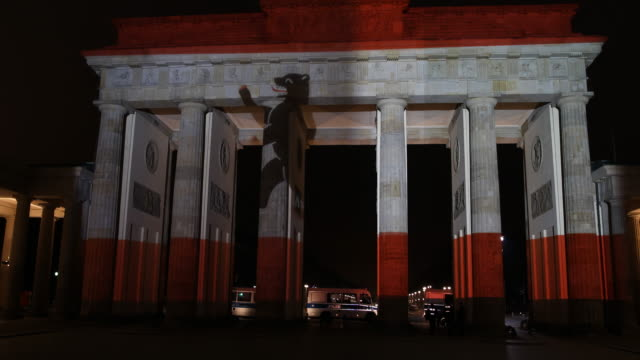 in commemoration of the victims of the terrorist attack the brandenburg gate was illuminated in the colors of the berlin flag on the 20th of december... - bear market stock videos and b-roll footage