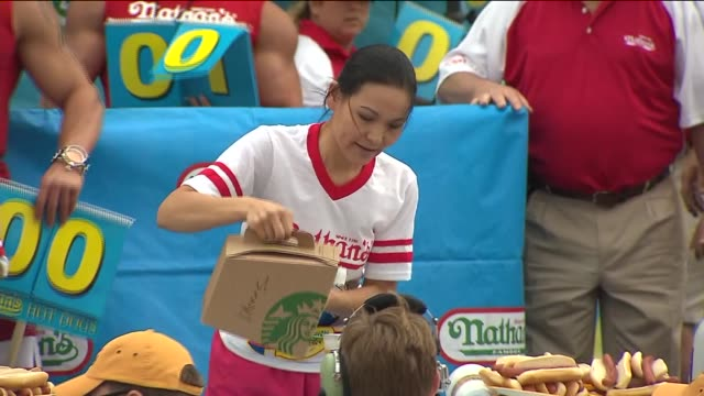 in coney island, joey chestnut wins coney island's hot dog contest for the 8th time and proposes to his long time girlfriend neslie ricasa. there was... - contestant stock videos & royalty-free footage