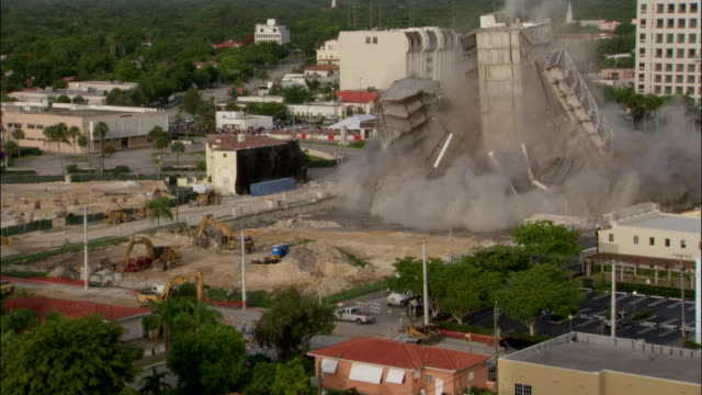 ws zi tu   in demolitionof building core remains stand  / coral gables, florida, usa - imploding stock videos and b-roll footage