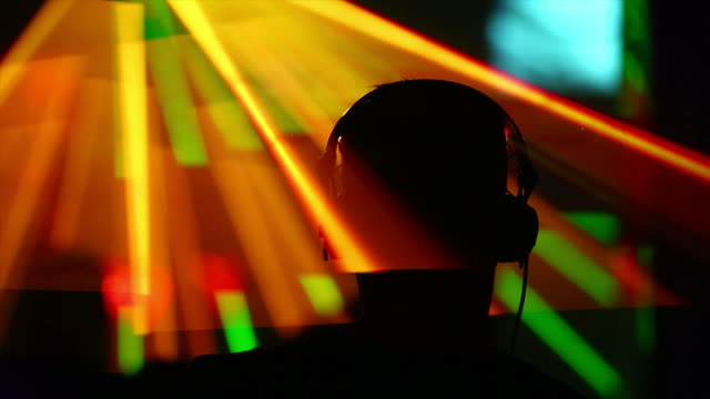 hd dj in disco back view - techno music stock videos & royalty-free footage