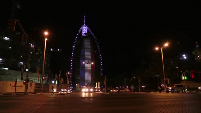 in dubai a banner of the french flag ran down the burj al arab while the burj al khalifa the worlds tallest building was lit up in red white and blue... - friday stock videos & royalty-free footage