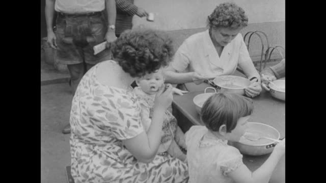 in east berlin men women and children write letters feed children and wait with their luggage - 1961 stock videos & royalty-free footage
