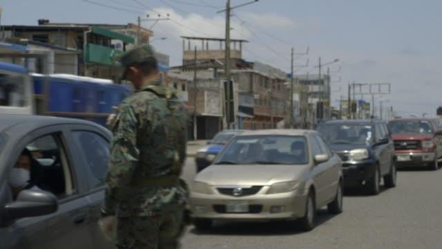 vídeos y material grabado en eventos de stock de in ecuador soldiers patrol the streets of guayaquil to enforce a curfew mandated by the government in an effort to stop the spread of the coronavirus... - ecuador