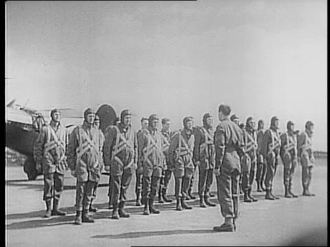 stockvideo's en b-roll-footage met in england / closeup of patch / shot of troops lined up / closeup soldiers faces / troops from the sky infantry stand at attention during inspection... - geallieerde mogendheden