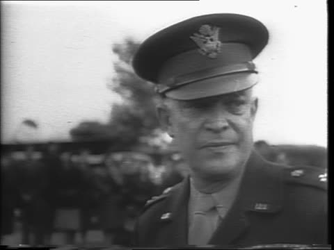 in england douglas c54 plane arriving at airport in england / general of the army dwight d eisenhower stepping down off plane / eisenhower wears cap... - down jacket stock videos and b-roll footage