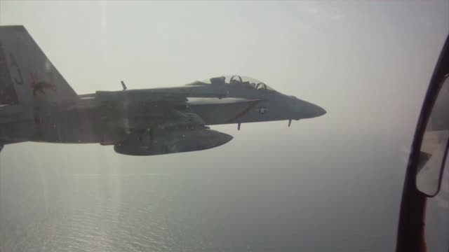 In flight footage from the cockpit of an F/A18F Super Hornet attached to the Fighting Black Lions of Strike Fighter Squadron 213 embarked aboard the...