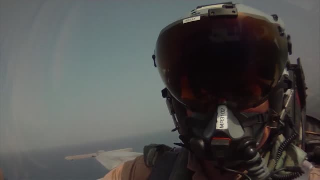 in flight footage from the cockpit of an f/a-18f super hornet, attached to the fighting black lions of strike fighter squadron 213 embarked aboard... - aircraft carrier stock videos & royalty-free footage