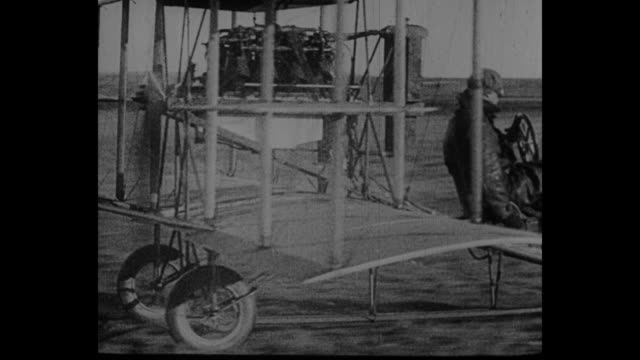 [vo in french throughout] french president armand fallieres looks on from grandstands at the paris air show in 1909 or so / louis charles breguet's... - glenn h. curtiss stock videos and b-roll footage