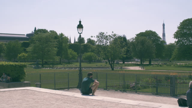 in front of the tuileries garden still closed with a few people france has started a progressive relaxation of its foreclosure measures and... - four people stock videos & royalty-free footage