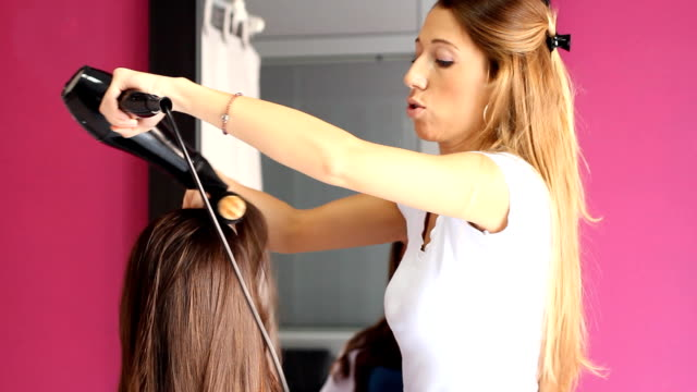 in hair salon - blow drying hair stock videos and b-roll footage