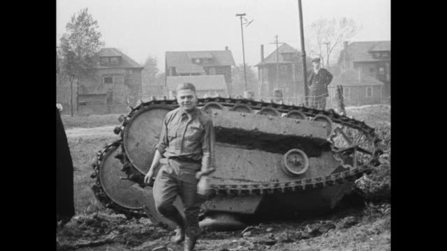 in highland park, michigan, tanks manufactured by ford powered by 2 model t engines are tested for use during wwi / overturned tank is uprighted by... - wwi tank stock videos & royalty-free footage