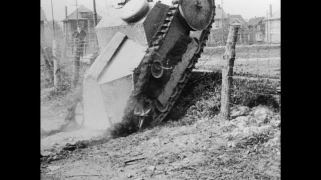 in highland park, michigan, tanks manufactured by ford powered by 2 model t engines are tested for use during wwi / tank drives over field as henry... - kampfpanzer stock-videos und b-roll-filmmaterial
