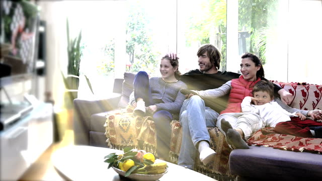 in holiday happy turkish family watching tv at home - comfortable stock videos & royalty-free footage