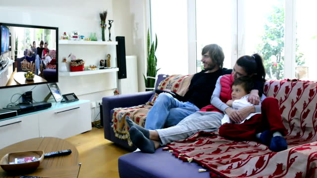 in holiday happy turkish family watching tv at home - family watching tv stock videos and b-roll footage