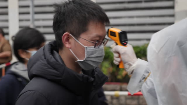 in hong kong, ordinary people are taking matters into their own hands, to protect themselves from the deadly virus coming over the border from china.... - report stock videos & royalty-free footage