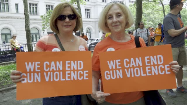 in honor all the lives taken and injured by gun violence as part of national gun violence awareness day activist, parents and students of all ages... - war stock-videos und b-roll-filmmaterial