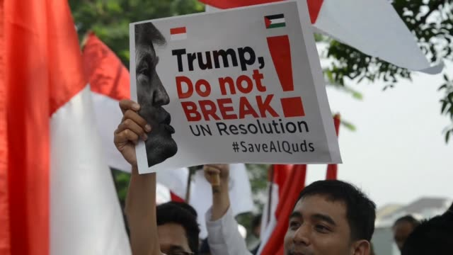in indonesia the world's most populous muslim majority country several hundred people demonstrated outside the us consulate general in the city of... - surabaya stock videos & royalty-free footage