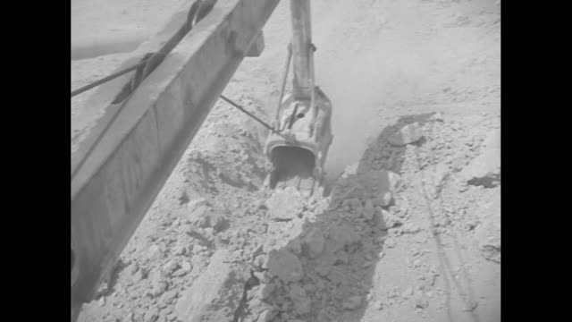 in iraq desert building oil pipeline / men and large pipes / arab man using jackhammer / jackhammer and feet / earth mover with mouthful of dirt /... - middle east stock videos & royalty-free footage