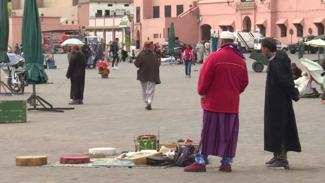 in jamaa el fna square, in the centre of marrakech, the tourist capital of morocco, horse-drawn carriages, taxis and shops are empty - tourism stock videos & royalty-free footage