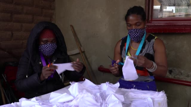in johannesburg's alexandra township the hluvuku designs sewing workshop has shifted its production from traditional textiles to reusable face masks - reusable stock videos & royalty-free footage