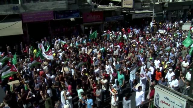 in jordan thousands of protesters on friday rallied in the capital amman to denounced israeli violence at the al aqsa compound - compounding stock videos and b-roll footage