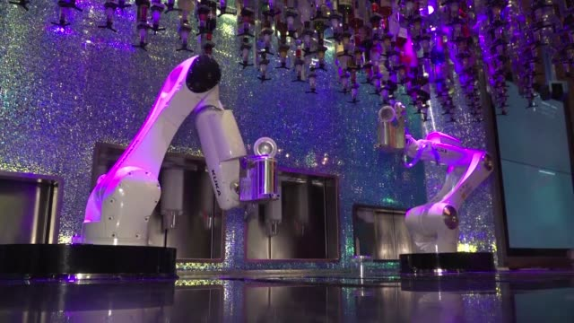 in las vegas customers seem to have taken to tipsy a robotic bartender one of a new wave of machines that can whip up cocktails at sports arenas... - offbeat stock videos and b-roll footage