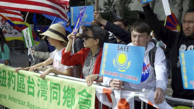 in light of china's 70th anniversary antichina demonstrators rally at dag hammarskjöld plaza across the street from the united nations headquarters... - central plaza hong kong stock videos and b-roll footage