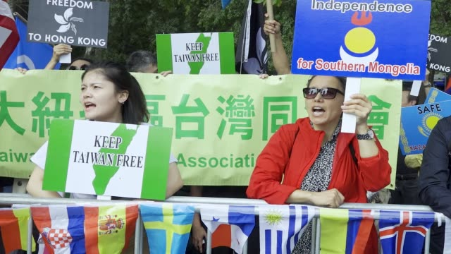 in light of china's 70th anniversary antichina demonstrators rally at dag hammarskjöld plaza across the street from the united nations headquarters... - central plaza hong kong stock videos & royalty-free footage