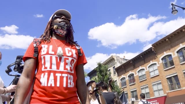 in light of gay pride month and the death of an african-american man george perry floyd jr. who has sparked worldwide protests, the transgender... - protestor stock videos & royalty-free footage