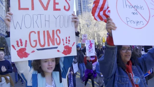 in light of the deadly mass shooting at marjory stoneman douglas high school in parkland florida a massive rally and march was held in new york city... - march for our lives stock videos and b-roll footage