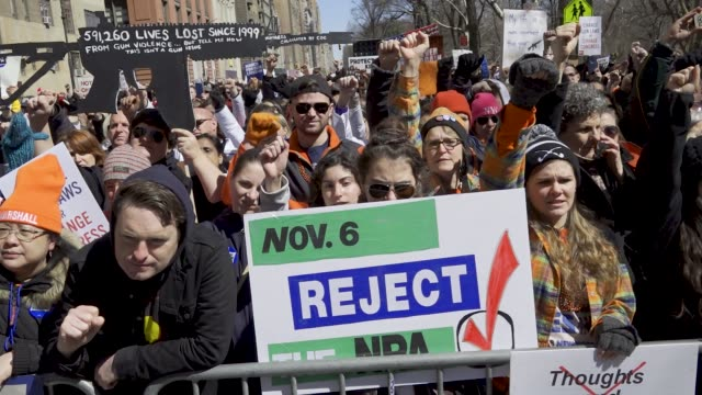 in light of the deadly mass shooting at marjory stoneman douglas high school in parkland florida a massive rally and march was held in new york city... - protesta contro la violenza armata video stock e b–roll