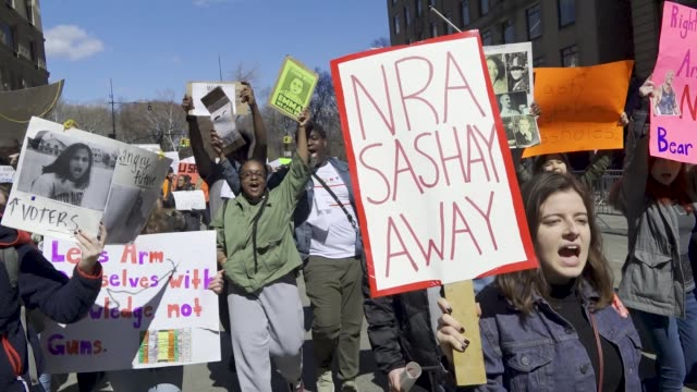 in light of the deadly mass shooting at marjory stoneman douglas high school in parkland, florida, a massive rally and march was held in new york... - gun violence protest stock videos & royalty-free footage