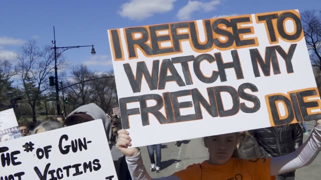 in light of the deadly mass shooting at marjory stoneman douglas high school in parkland florida a massive rally and march was held in new york city... - march for our lives video stock e b–roll