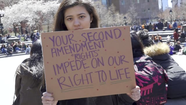 in light of the deadly mass shooting at marjory stoneman douglas high school in parkland, florida and other related gun violence incidents, high... - gun violence protest stock videos & royalty-free footage