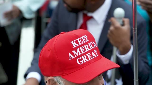 in light of the november 3, 2020 presidential election maga president donald trump supporters rally midtown manhattan's herald square, new york city... - baseballmütze stock-videos und b-roll-filmmaterial