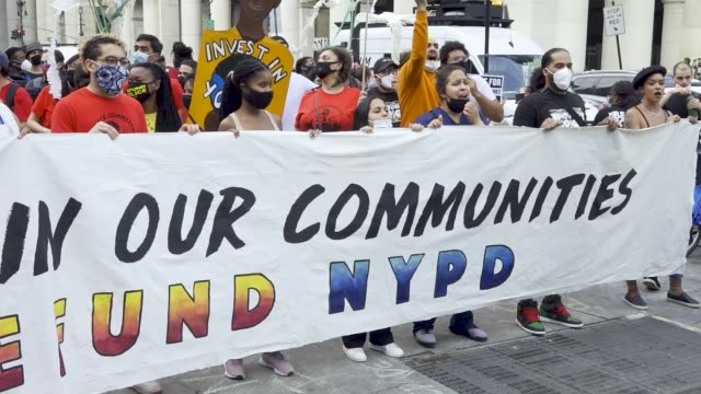in light of the worldwide protests sparked by the death of george floyd demonstrators rallied in downtown manhattan and marched across the brooklyn... - banner sign stock videos & royalty-free footage