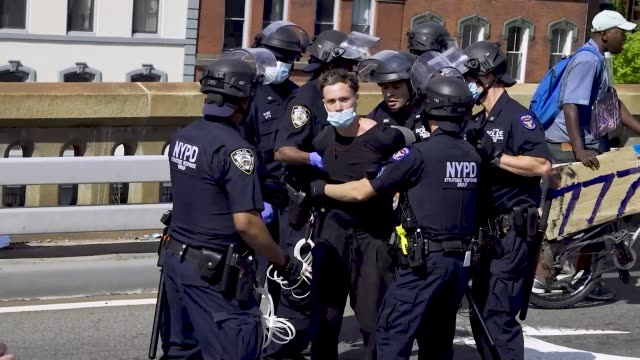 in light of the worldwide protests sparked by the death of george floyd, pro-police and black lives matter anti-police protesters clashed on the... - protestor stock videos & royalty-free footage