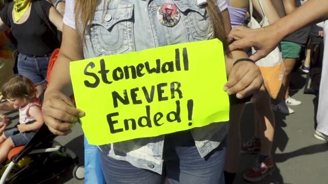 in light of world gay pride month transgender women and gender nonconforming rallied in washington square park in the west village to protest the... - stone wall stock videos & royalty-free footage