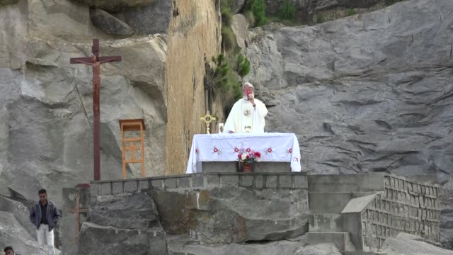 in madagascar, father pedro celebrates easter mass alone on an outdoor altar due the measures in place to combat the spread of the coronavirus - easter stock videos & royalty-free footage
