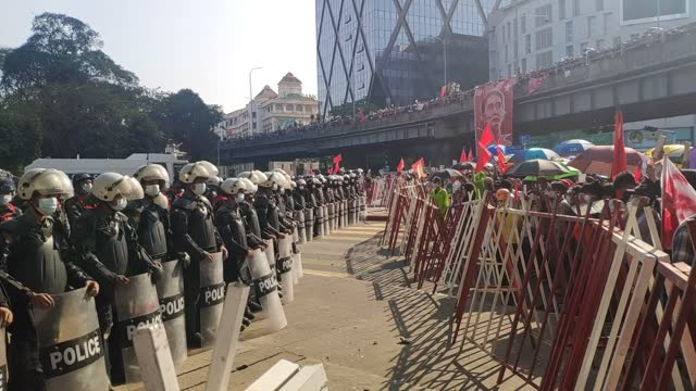 in myanmar, protesters took to the streets on tuesday for the fourth straight day, defying the military's warning of legal action on public... - ミャンマー点の映像素材/bロール