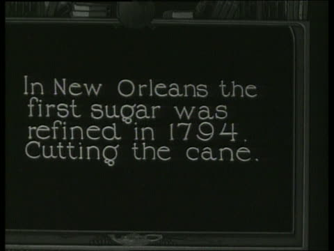 """slate """"in new orleans the first sugar was refined..."""" / 1910 / no sound - 1910 stock-videos und b-roll-filmmaterial"""
